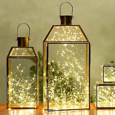 fill glass lanterns with delicate tangles of lights instead of 28