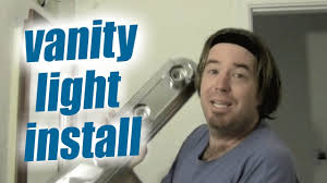 how to replace a vanity light fixture in your bathroom easy home