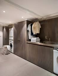 contemporary laundry room cabinets minneapolis hanging clothes rack laundry room beach style with