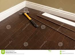 hammer laminate flooring and baseboard molding stock photos