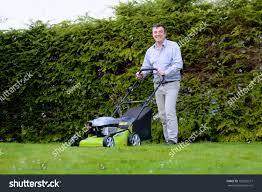 happy man mowing lawn backyard his stock photo 183295577