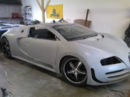 unfinished bugatti veyron replica lies on a 2004 pontiac gto