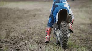 small motocross bikes motocross racer starting engine of his dirt bike riding away