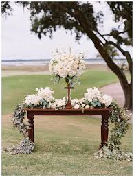 outdoor wedding ceremony altar table with white florals and