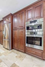 how to trim cabinet above refrigerator working with a built in appliance cabinets