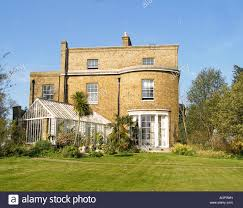 typical english country house and garden stock photo royalty free
