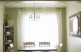 Dining Room Formal Drapes With Modern Chandeliers And Wall