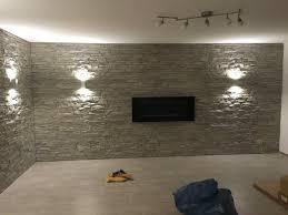 naturstein wohnzimmer wohnzimmerwand in steinoptik kunststein wie naturstein das