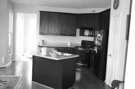 kitchen island with corner black wooden kitchen cabinets and rectangle kitchen island