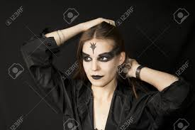 halloween gothic with a black make up of eyes and lips stock