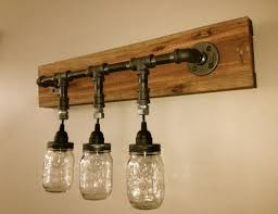 diy mason jar light with iron pipe mason jar vanity light mason jar wall light von chicagolights