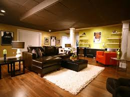 wonderful sports themed basement living room with wooden laminate