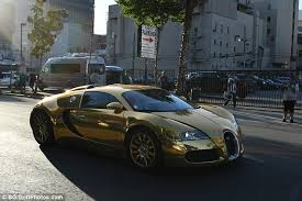 bugatti gold and jamie foxx pulls up to premiere in gold bugatti veyron daily mail