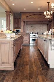 Luxury Traditional Kitchens - creamy white island using ornate tulip styled chandelier for