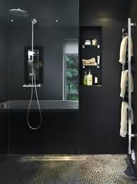 simple shower room with dark wall decor natural stone floor and