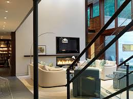 view in gallery contemporary living room with tv above the fireplace