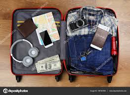 travel accessories images Packed suitcase with travel accessories stock photo belchonock jpg