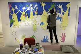 a look inside springfield s new dr seuss museum the artery cortney thibodeau a senior at umass amherst paints a mural based on artwork from