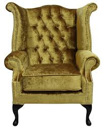 High Armchairs Gold Velvet Chesterfield High Back Wing Chair Designersofas4u