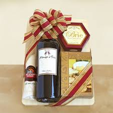 wine and cheese gifts wooden cutting board and wooden cheese spreader 1 bottle of
