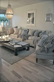 contemporary living room with hardwood floors pendant light