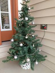 thrifty treasures reuse a christmas tree top there is my simple tree top to porch tree rescue