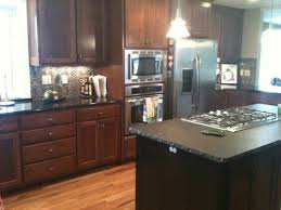 Can You Stain Kitchen Cabinets Darker How Can I Brighten Up My Dark Kitchen My Kitchen Has Black Granite