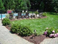 Landscaping Around Pools retaining wall and landscape around pool pool ideas pinterest