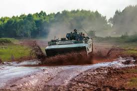 amphibious vehicle military type 001 amphibious armored personnel carrier wades through mud