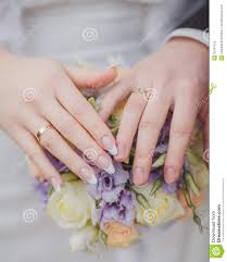 beautiful hand rings images Hands and rings on the wedding bouquet stock image image of jpg