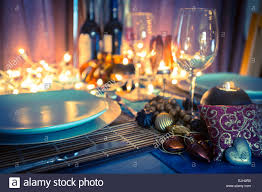 table setting and decorations for romantic dinner with candles