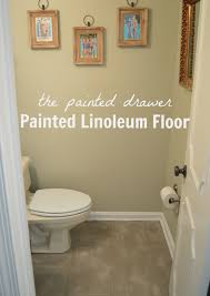 love this chalk paint and stenciling on a linoleum bathroom