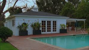 day low angle small white backyard guest house pool house french