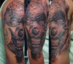 cute small crazy clown mask tattoo design idea for men and women