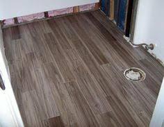 Luxury Vinyl Bathroom Flooring Heartridge Luxury Vinyl Plank Flooring In Smoked Oak Greystone