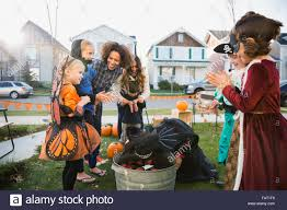 kids in halloween costumes bobbing for apples stock photo royalty
