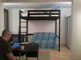 Black Wooden Bunk Beds Furniture Black Wooden Bunk Bed With Ladder On Brown Wooden