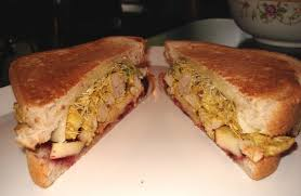 pom pom cuisine curry chicken sandwich with sprouts cranberry chutney and apples