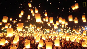 floating lanterns light up the sky in thailand festival