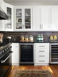 white kitchen cabinets with black subway tile backsplash 35 ways to use subway tiles in the kitchen digsdigs