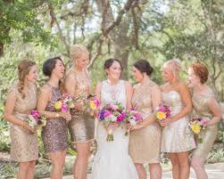 short gold sequin bridesmaid dresses and pink and yellow bouquets