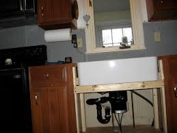 retrofiting a farmhouse sink in existing cabinetry question