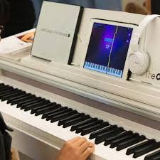keyboard that lights up to teach you how to play the one smart piano teaches you to play using an ipad the verge