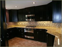 Kitchen Backsplash Dark Cabinets by Black Kitchen Cabinet And Kitchen Island With Bianco Antico