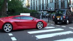 Lamborghini Gallardo Coupe - red lamborghini gallardo coupe driving and accelerating in