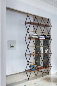 Ceiling To Floor Bookshelves Pietro Russo Designs A Floor To Ceiling Shelf U0026 Space Divider
