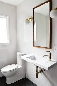 black and white bathroom features walls clad in a white