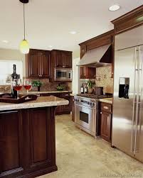 kitchen wall color ideas with cherry cabinets a luxury kitchen with cherry cabinets and a large island
