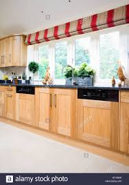 red beige wide striped blind on large window in modern country