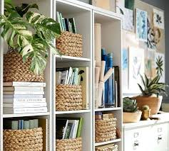 bookcases filled with baskets decorating a bookcase storage